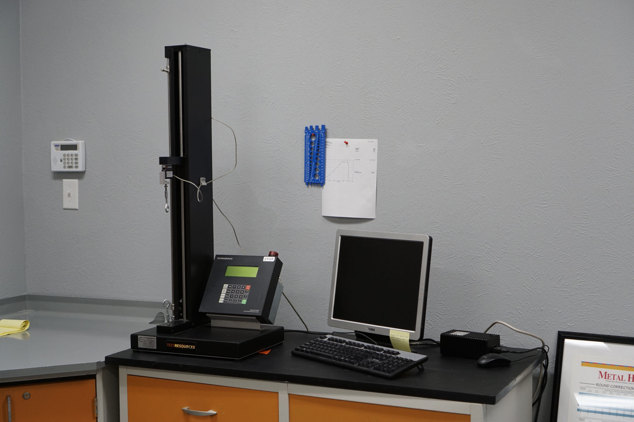 Testresources tensile machine capable of 250 pounds of force.