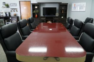 Our conference room is equipped with easy chairs, a coffee bar and cold beverages.